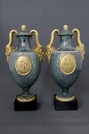 Porphyry vases on black plinths (pair)