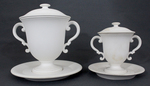 Double handled cups with saucer and lid