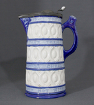 Beer stein with pewter cap