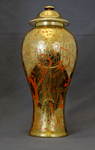 Cooper lustre vase with lid